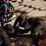 Protestors settling in playing games. The London Stock Exchange was attempted occypied in solidarity with Occupy Wall in Street in New York and in protest againts the economic climate, blamed by many on the banks. Police managed to keep people away fro the Patornoster Sqaure and the Stcok Exchange and thousands of protestors stayid in St. Paul's Square, outside St Paul's Cathedral. Many camped getting ready to spend the night in the square.