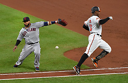 June 21, 2017 - Baltimore, MD, USA - The Baltimore Orioles' Adam Jones, right, is safe on an infield single as Cleveland Indians first baseman Carlos Santana can't grab the ball and make the tag in the fourth inning at Oriole Park at Camden Yards in Baltimore on Wednesday, June 21, 2017. The Indians won, 5-1. (Credit Image: © Lloyd Fox/TNS via ZUMA Wire)