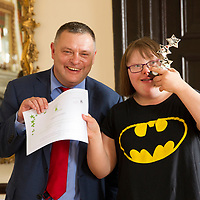 Children belonging to Cheshire Down's Syndrome Support Group receiving awards from Weaver Vale MP, Mike Amesbury (Labour)