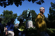 The Blue Ribbon Commission on Race, Memorials and Public Spaces held a discussion next to the statue in Lee Park during a public tour of monuments and public spaces Saturday in Charlottesville, Va. Photo/The daily Progress/Andrew Shurtleff