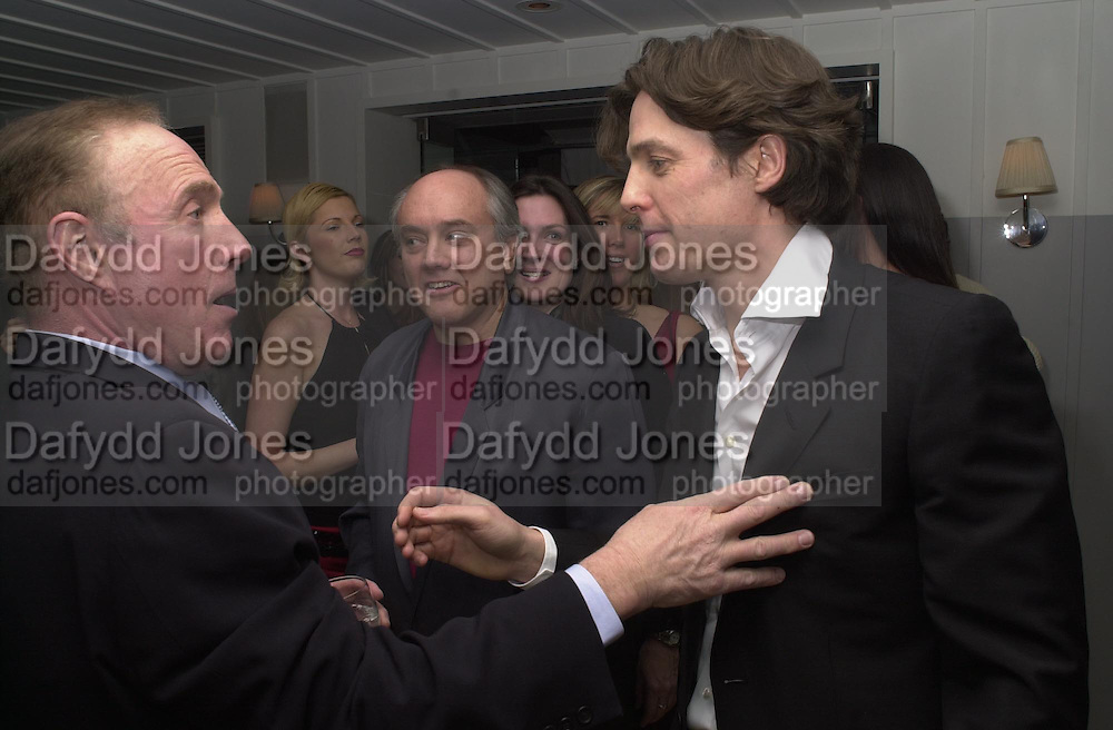 James Caan and Hugh Grant. Mike Radford in centre. Talk pre-Golden Globes party. Mondrian Hotel.West Hollywood, California USA  20 January 2001. © Copyright Photograph by Dafydd Jones 66 Stockwell Park Rd. London SW9 0DA Tel 020 7733 0108 www.dafjones.com