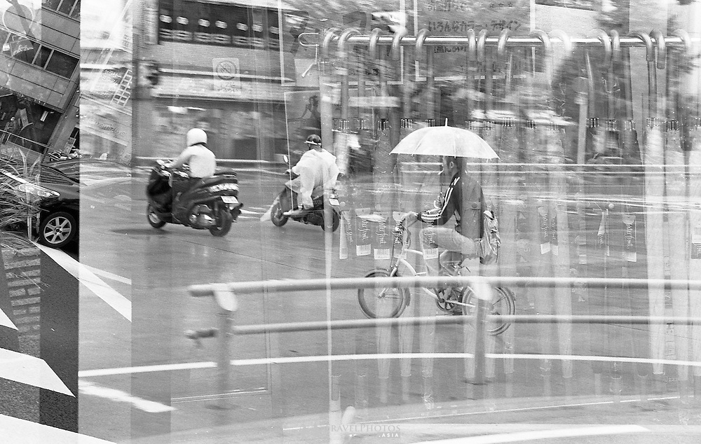 Double exposures taken of the city on grainy film. Minotla Alpha Sweet II, Tamron 28-75mm, Ilford Delta 400. Image may contain dust spots and other charisma.