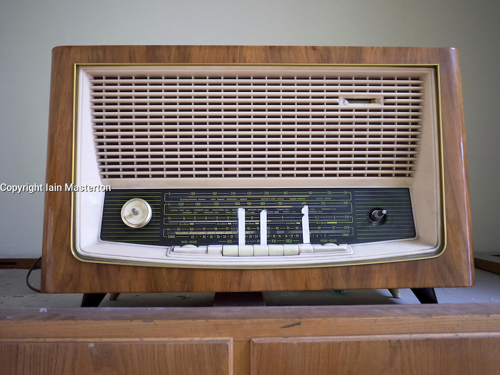 Old radio with East German stations marked by tape at the former STASI or state secret police headquarters now museum in Berlin Germany