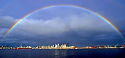 A rainbow appears over downtown Seattle as a bit of sun breaks through the gray enveloping the city. (Tom Reese / The Seattle Times, 2004)