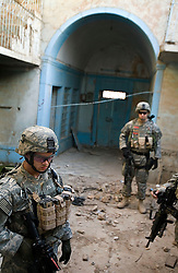 Pvt. Jason Garcia and other members of the 1st Infantry, 17th Regiment, help Iraqi forces patrol in western Mosul, Iraq, Dec. 14, 2005. This is part of an effort to provide security in preparation for Iraq's first post-Saddam parliamentary elections. The western sector is home to Mosul's primarily Sunni population, which has been resistant to the American presence in Iraq.