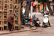 An elderly woman walking with a cane passes traditional bamboo construction materials in Hanoi, a scene from Vietnam's past. She walks toward a younger woman with a motorbike and cell phone, material possessions of the country's new affluence. Robert Dodge, a Washington DC photographer and writer, has been working on his Vietnam 40 Years Later project since 2005. The project has taken him throughout Vietnam, including Hanoi, Ho Chi Minh City (Saigon), Nha Trang, Mue Nie, Phan Thiet, the Mekong, Sapa, Ninh Binh and the Perfume Pagoda. His images capture scenes and people from women in conical hats planting rice along the Red River in the north to men and women working in the floating markets on the Mekong River and its tributaries. Robert's project also captures the traditions of ancient Asia in the rural markets, Buddhist Monasteries and the celebrations around Tet, the Lunar New Year. Also to be found are images of the emerging modern Vietnam, such as young people eating and drinking and embracing the fashions and music of the West. His book. Vietnam 40 Years Later, was published March 2014 by Damiani Editore of Italy.