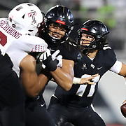ORLANDO, FL - NOVEMBER 14:  Dillon Gabriel #11 of the Central Florida Knights attempts a pass in a game against the Temple Owls at Bounce House-FBC Mortgage Field on November 14, 2020 in Orlando, Florida. (Photo by Alex Menendez/Getty Images) *** Local Caption *** Dillon Gabriel