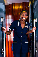 Train hostess aboard the Rovos Rail Pride of Africa train at the station at Kimberley, en route to Cape Town, South Africa.