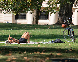 © Licensed to London News Pictures. 22/09/2020. London, UK. An office workers in St James's Park enjoys the last rays of sun before a break in the weather tomorrow with temperatures down by 10c with wind and rain forecast. Prime Minister Boris Johnson has announced further tougher Covid restrictions with a 10pm curfew on pubs and restaurants and a £200 fine for not wearing a mask and for breaking the rule of six as a spike in coronavirus rates continues across the country. Photo credit: Alex Lentati/LNP