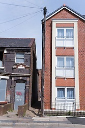 New build three storey flats next to a row of houses ready for demolition in a designated area for the pathfinder regeneration scheme Bootle; Liverpool; England,