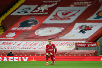 Football - 2020 / 2021 Premier League - Liverpool vs Sheffield United - Anfield<br /> <br /> Liverpool's Jordan Henderson takes the knee at the start of the match<br /> <br /> COLORSPORT/TERRY DONNELLY