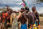 Portrait of Samburu warriors being painted, ,Samburu, Kenya, Africa