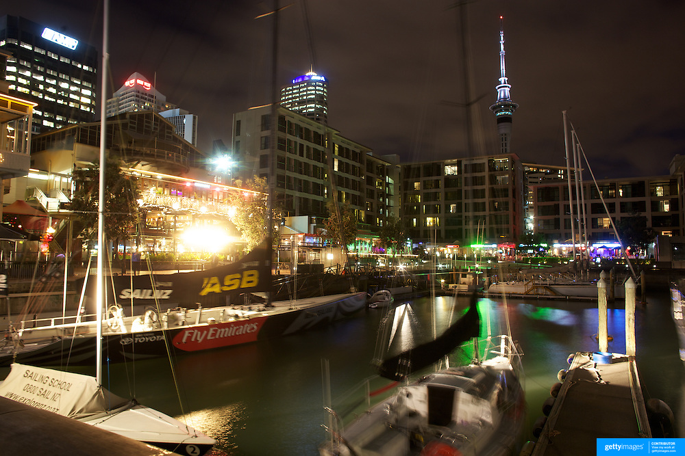 Moored yachts in Viaduct Basin at night time with Sky Tower in the background. Auckland, New Zealand, .Located in the heart of Auckland City, Viaduct Basin and Harbour is a first class residential, commercial and entertainment precinct..The marina caters to commercial vessels, pleasure craft and super yachts with 150 marina berths ranging in size up to 60 metres..Viaduct Basin hosts many fabulous events including the past America's Cup defences, Louis Vuitton Regattas, the Volvo Round the World Race stopover, Auckland International Boatshow and New Zealand Fashion Week..Visitors can explore New Zealand's rich maritime history at Voyager Maritime Museum, cruise the harbour on a charter yacht, view the yachts berthed in the harbour and enjoy the world class hospitality at the many bars and restaurants that line the waters edge..New Zealand's largest marine service precinct, Westhaven, lies a short walk to the west.. Auckland, New Zealand. 25th November 2010. Photo Tim Clayton.