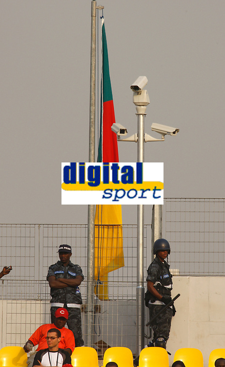 Photo: Steve Bond/Richard Lane Photography.<br />Egypt v Cameroun. Africa Cup of Nations. 22/01/2008. The local police look on under the Ghana flag