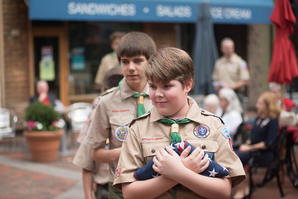 Members of Boy Scouts of America Troop 439 prepare to raise the American Flag.