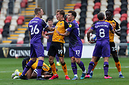 Newport County's Scott Twine (19) reacts angrily to the challenge on his Captain Joss Labadie (4) during the EFL Sky Bet League 2 match between Newport County and Tranmere Rovers at Rodney Parade, Newport, Wales on 17 October 2020.