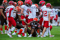 KELOWNA, BC - AUGUST 17:  Kelton KOURI #38 lends a hand to Malcom MILLER #3 of Okanagan Sun after being tackled by the Westshore Rebels  at the Apple Bowl on August 17, 2019 in Kelowna, Canada. (Photo by Marissa Baecker/Shoot the Breeze)