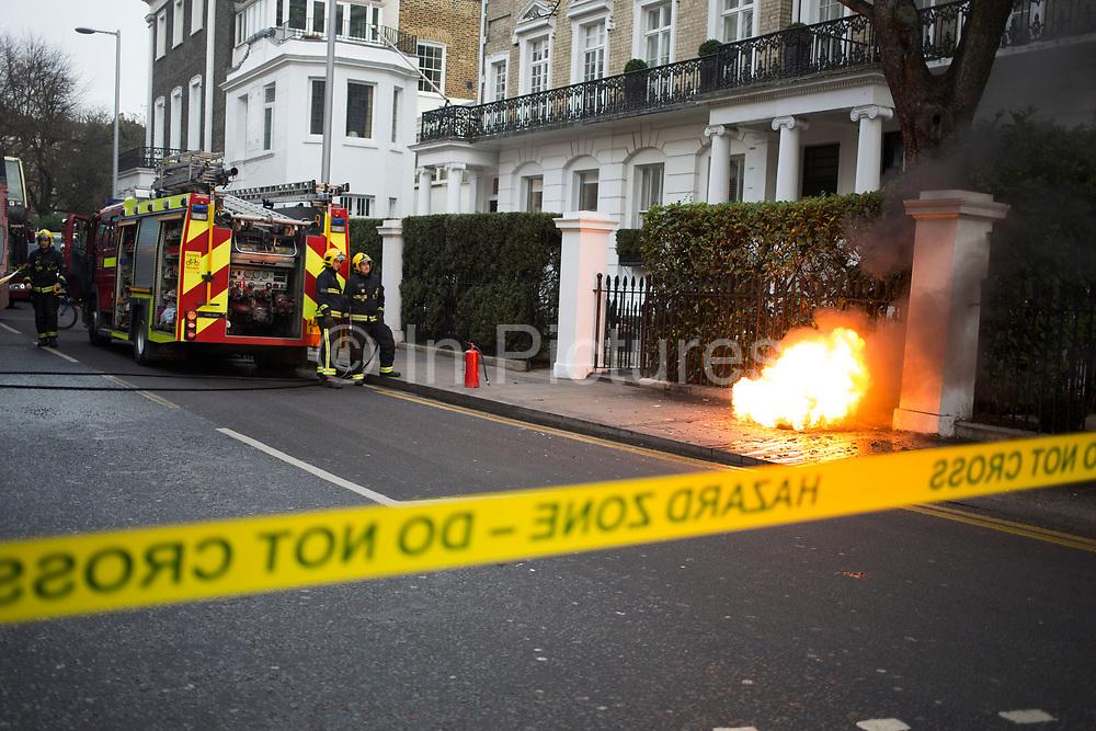 London Fire Brigade firefighters attend an electrical blaze in West London, England, United Kingdom.