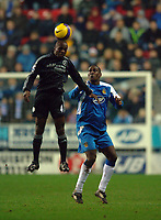 Photo: Paul Greenwood.<br />Wigan Athletic v Chelsea. The Barclays Premiership. 23/12/2006. Chelsea's Claude Makelele, left, outjumps Emile Heskey.