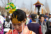 A shrine maiden  during the Kanamara matsuri or festival of the Steel phallus Kawasaki Daishi, Kawasaki, Kanagawa, Japan. Sunday, April 2nd 2017. The Kanamara Penis festival takes place on the first Sunday of April and celebrates the local legend of a penis eating demon who was defeated after being tricked into biting a steel phallus. The festival is popular with Japan's gay community and now uses its notoriety to raise money for HIV and AIDS charities. It is also wildly popular with foreign and Japanese.tourists.