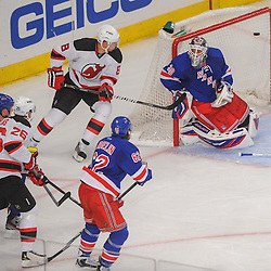 New Jersey Devils center Patrik Elias (26) scores a short-side goal on New York Rangers goalie Henrik Lundqvist (30) during second period NHL action between the New Jersey Devils and the New York Rangers at Madison Square Garden in New York, N.Y. The Rangers defeated the Devils 4-2.