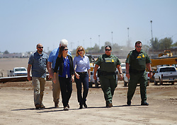 April 18, 2018 - San Diego, CA, USA - U.S. Department of Homeland Security Secretary Kirstjen M. Nielsen, middle, stops for a brief visit along the U.S.-Mexico border, where construction for the bollard fence is currently underway along the border in Calexico on Wednesday, April 18, 2018. (Credit Image: © Nelvin C. Cepeda/TNS via ZUMA Wire)