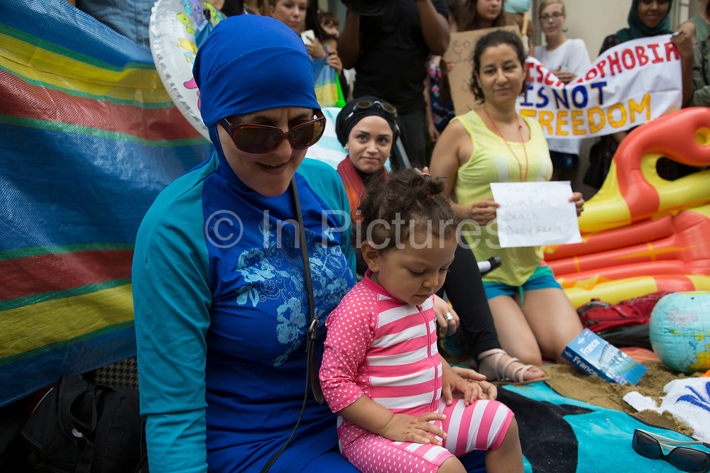 "Wear what you want protest at the French embassy against the burkini ban for Muslim women on France's beaches on 25th August 2016 in London, United Kingdom. Activists called on fellow supporters to descend on Knightsbridge saying ""Come along to the French embassy and wear what you want - burkinis, bikinis, anything goes. Bring beach gear: beach umbrellas, towels, bat and ball, boules... Join us at the French embassy to show solidarity with French Muslim women and to call for the repeal of this oppressive law by the French Government."""