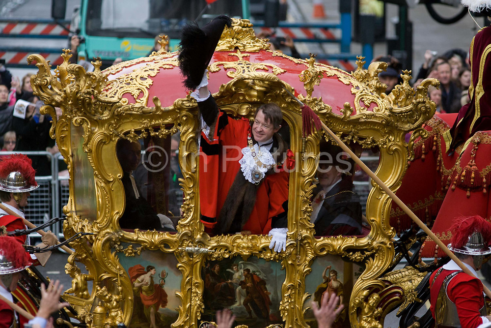 Alderman and Rt Hon The Lord Mayor of London, Roger Gifford, a merchant banker with Swedish bank SEB waves to crowds during the Lord Mayor's Show. He is the 685th in the City of London's ancient history. The new Mayor's procession consists of a 3-mile, 150-float parade of commercial and military organisations going back to medieval times. This is the oldest and longest civic procession in the world that has survived the Plague and the Blitz, today one of the best-loved pageants. Henry Fitz-Ailwyn was the first Lord Mayor (1189-1212) and ever since, eminent city fathers (and one woman) have taken the role of the sovereign's representative in the City – London's ancient, self-governing financial district. The role ensured the King had an ally within the prosperous enclave.