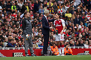 Hector Bellerin of Arsenal speaks to manager Arsene Wenger during a break in play.  Premier league match, Arsenal v AFC Bournemouth at the Emirates Stadium in London on Saturday 9th September 2017. pic by Kieran Clarke, Andrew Orchard sports photography.