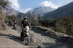 Grant Peterson with the Annapurna Range in the background on Day-7 of our Himalayan Heroes adventure riding from Tatopani to Pokhara, Nepal. Monday, November 12, 2018. Photography ©2018 Michael Lichter.
