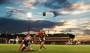 Luke Parker of the swans and Greg Broughton of the Suns contest the ball during the 2013 NAB Cup round 03 match between the Sydney Swans and the Gold Coast Suns at Blacktown International Sportspark, Sydney. (Photo: Craig Golding/AFL Media)