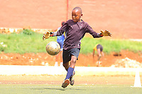 """U.K. soccer club Arsenal and the Rwandan Development Board announced a sponsorship deal in late May 2018 which will see """"Visit Rwanda"""" printed on the sleeves of the Arsenal kit for the next 3 seasons at a cost to the Rwanda Development board of £10million per season. It is  intended to promote tourism to Rwanda. Here young Rwanda boys play football in Kigali"""