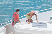 IBIZA, SPAIN, 2016, JULY 13 <br /> <br /> Cristiano Ronaldo with all family Ibiza<br /> <br /> After winning his first European Championship, Cristiano Ronaldo  enjoy a well deserved vacation in the paradisiacal beaches of Ibiza, one of his favorite destinations. The Portuguese striker landed on Tuesday at noon on the island accompanied by his son cristianinho, his mother, Dolores Aveiro and a large group of friends. The whole group enjoyed a fun day at sea where the Real Madrid star showed his most endearing facet. The consecrated footballer took the opportunity to take a refreshing dip.  Wearing a green apple bathing suit, showed off his muscled torso while delighting everyone present with his risky pirouettes to jump into the sea. His son looked excited the spectacle offered by her proud dad<br /> ©Exclusivepix Media