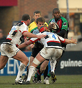 Twickenham, GREAT BRITAIN, Quins Ugo MONYA, supported by Will SKINNER attempts to Mis Hugh VYVYANS tackle, [red hat], during the Guinness Premiership game Harlequins [Quins] vs Saracens at the Stoop, Middx, 22/12/2007  [Mandatory Credit Peter Spurrier/Intersport Images]