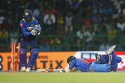 September 3, 2017 - Colombo, Sri Lanka - Sri Lankan wicket keeper Niroshan Dickwella (L) removes the bails as Indian cricketer Manish Pandey dives in to survive a run out  during the 5th and final One Day International cricket match between Sri Lanka and India at the R Premadasa international cricket stadium at Colombo, Sri Lanka on Sunday 3 September 2017. (Credit Image: © Tharaka Basnayaka/NurPhoto via ZUMA Press)