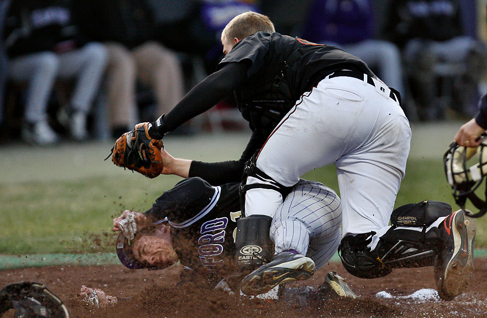 Kennewick catcher Tyler Morfin tags out Hanford's Josh Oslund at the back end of a double steal during Kennewick's 13-3 win over Hanford at Waits Field in Richland on March 31, 2009.