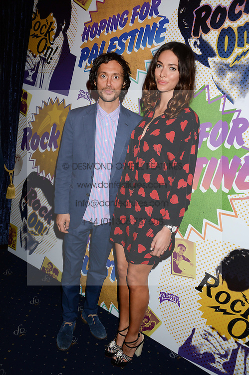 DAN MACMILLAN and LIZZY BOWDEN at the Hoping Foundation's 'Rock On' Benefit Evening for Palestinian refuge children held at the Cafe de Paris, London on 20th June 2013.