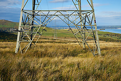 Pylons from Wylfa Nuclear Power Station crossing over Snowdonia National Park above Llanfairfechan North Wales 2015