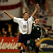 England's Michael Owen celebrates after scoring the second goal against Denmark
