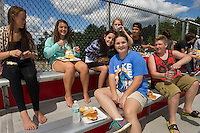 Incoming freshmen (back l-r) Molly Fernandes, Taylor Morrill, Kelsea Turcotte, Caitlin Beattie and Jeremy Connolly  (front l-r) Morgan Ronprey and Shawn Zappala enjoy a bbq lunch in the stands following their two hour freshmen orientation on Thursday morning.  (Karen Bobotas/for the Laconia Daily Sun)