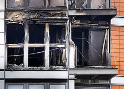 © Licensed to London News Pictures. 07/05/2021. London, UK. Cordon tape can be seen inside the charred remains of apartments at New Providence Wharf in Poplar in east London. 100 fire fighters and 20 crews tackled the blaze at it's peak. Photo credit: Peter Macdiarmid/LNP