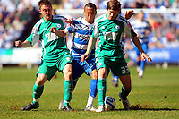 © Andrew Fosker / Richard Lane Photography 2010 - Reading's  Ryan Bertrand tries to get past Josh Simpson (R) and Lee Frecklington (L) Reading v Peterborough - Coca-Cola Championship - 17/04/2010 - Madejski Stadium - Reading - UK.