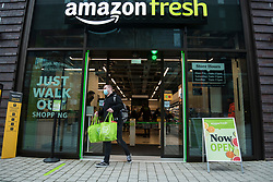 "© Licensed to London News Pictures. 16/03/2021. LONDON, UK.  Outside the new 2,500 sq ft Amazon Fresh store in Wembley Park, west London on its opening day. It is the second ""just walk out"" grocery store in the UK after the opening of the Wembley branch.  As a ""contactless"" shop, it is available to anyone signed up to Amazon and with the app on their smartphone.  In-store cameras and artificial intelligence monitor customers picking up items who simply walk out and billing takes place later automatically.  Photo credit: Stephen Chung/LNP"