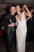 JULIAN MACDONALD; YASMIN MILLS, Pete & Caroline Tong and Yasmin Mills Christmas Party. Baroque, The Playboy Club, Old Park Lane, London. 15 December 2012.