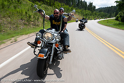 Buttera's Metal Werx' Tina and Brian Buttera on the Cycle Source ride down Vanocker Canyon back from Nemo to the Iron Horst Saloon during the Sturgis Black Hills Motorcycle Rally. SD, USA. Wednesday, August 7, 2019. Photography ©2019 Michael Lichter.