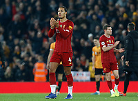 Football - 2019 / 2020 Premier League - Liverpool vs. Wolverhampton Wanderers<br /> <br /> Virgil van Dijk and James Milner of Liverpool applaud the Kop at the final whistle, at Anfield.<br /> <br /> COLORSPORT/ALAN MARTIN