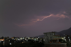 April 26, 2018 - Kathmandu, NP, Nepal - Lightning flashes illuminates the sky during a thunderstorm over  Kirtipur, Kathmandu, Nepal on Thursday, April 26, 2018. (Credit Image: © Narayan Maharjan/NurPhoto via ZUMA Press)