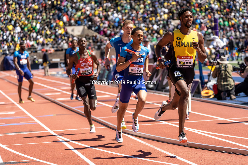 Daniel Glave (JAM) and Rob Ford (USA) competing in the USA vs the World Men Sprint Medley at the 2019 Penn Relay .