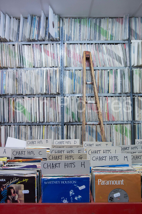 Vinyl records piled high at Wanted Music record shop in Beckenham on the 4th May 2018 in South London in the United Kingdom.