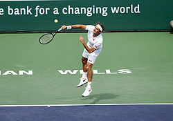 March 10, 2019 - Indian Wells, CA, U.S. - INDIAN WELLS, CA - MARCH 10: Roger Federer (SUI) hits a serve during the second round of the BNP Paribas Open on March 10, 2019, at the Indian Wells Tennis Gardens in Indian Wells, CA. (Photo by Adam Davis/Icon Sportswire) (Credit Image: © Adam Davis/Icon SMI via ZUMA Press)